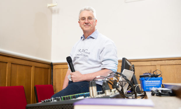 Rev Graham Crawford with some of the equipment installed last year to enable services to be broadcast.