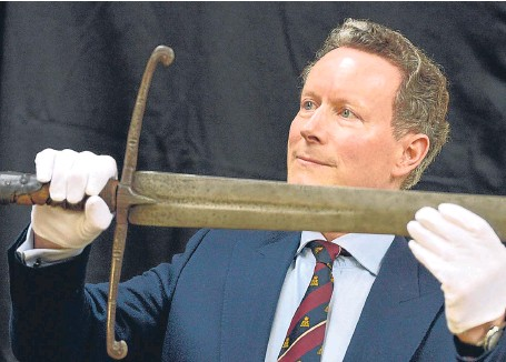 Lord Bruce with sword of his ancestor, King Robert.