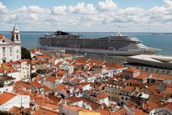 A view of the docked MSC Fantasia cruise ship, where Portuguese authorities began the coronavirus testing and repatriation process for 1,338 passengers, at the port in Lisbon, Portugal March 22, 2020.
