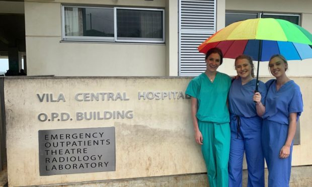 From left: Harriet Greig and Eilidh Martin alongside Lindsay Wallace outside the hospital they were working at in Vanuatu