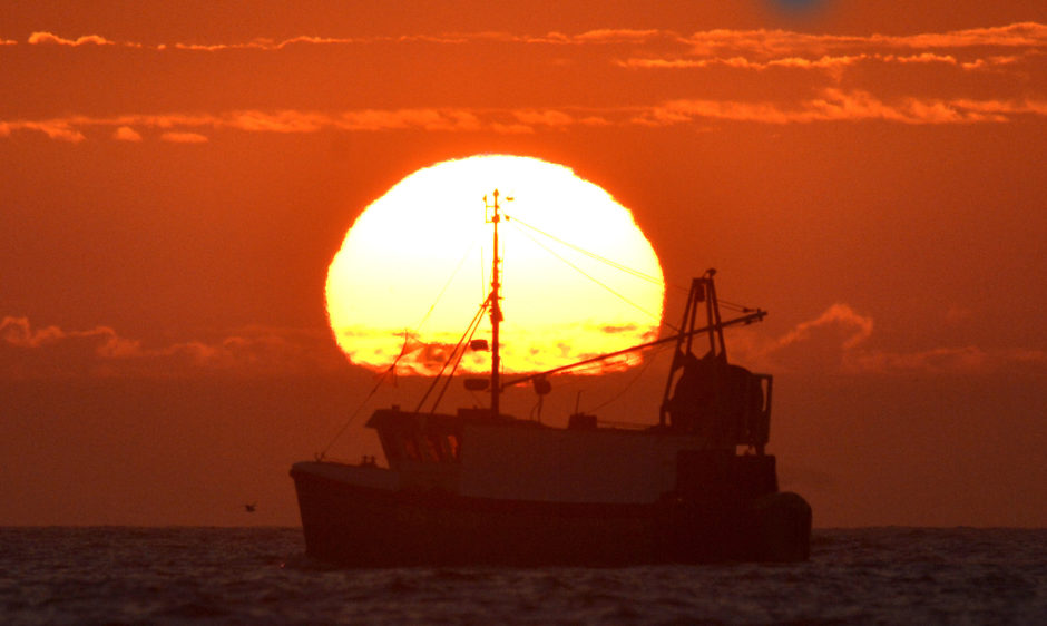 The sun rises over fishermen setting off for a day's fishing on the North Sea.