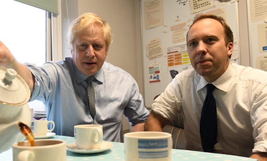 Prime Minister Boris Johnson with Health Secretary Matt Hancock.
