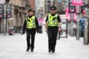 Police patrol the streets of Glasgow during the coronavirus lockdown.