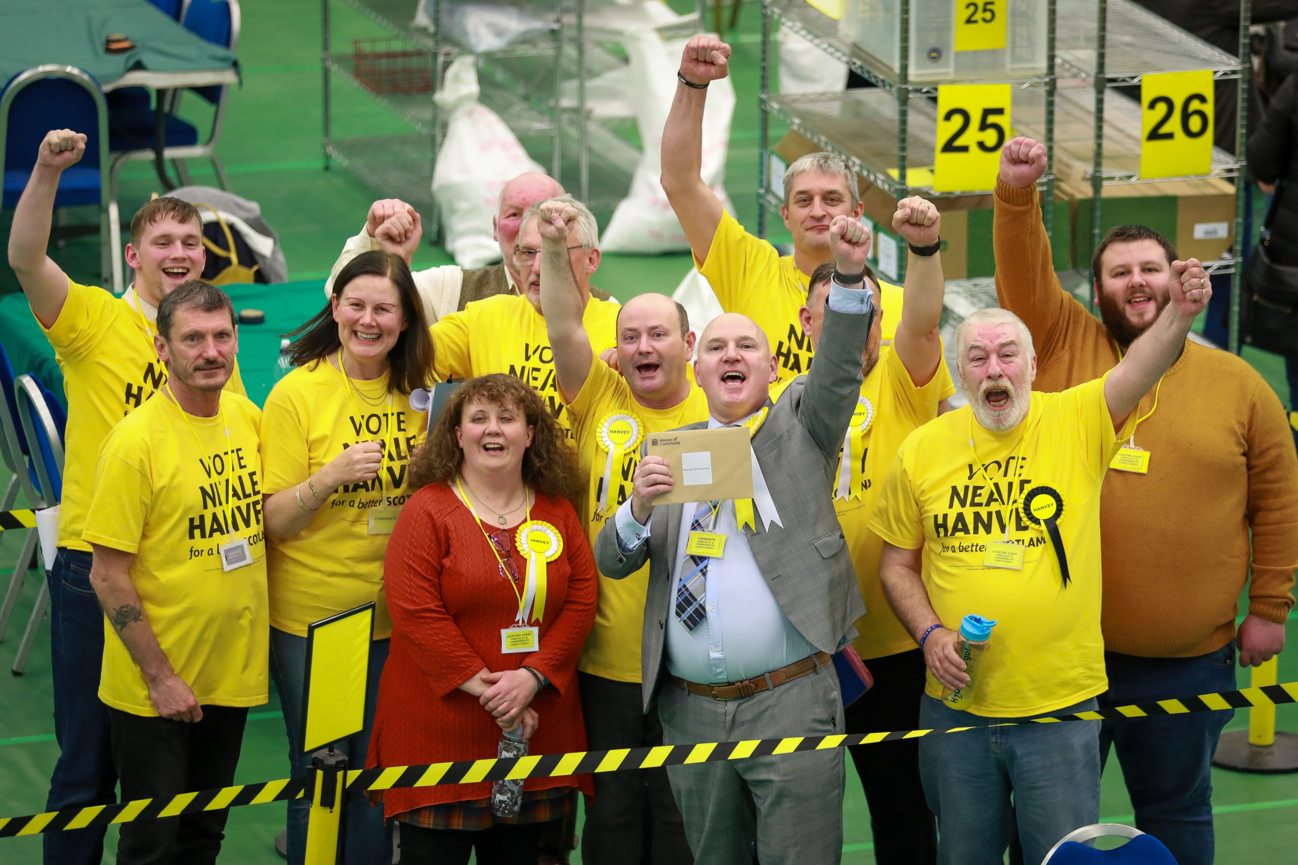 Neale Hanvey and supporters celebrate after his General Election victory.