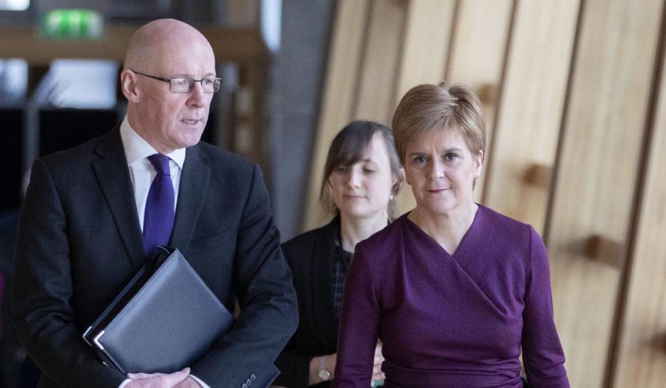 John Swinney and Nicola Sturgeon on their way to the Scottish Parliament debating chamber on Thursday.