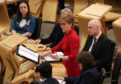 First Minister Nicola Sturgeon in the debating chamber during FMQs.