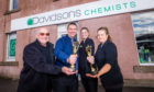 Delivery driver Peter Thomson, manager Andrew Watson and pharmacy assistants Jaime Rodger and Nicola Smith have celebrated the win.