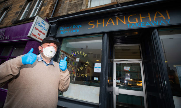 Shanghai Takeaway in Perth  is still operating as a delivery provider with staff wearing clothes and face masks.