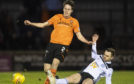 Liam Smith of United is tackled by Alan Forrest.