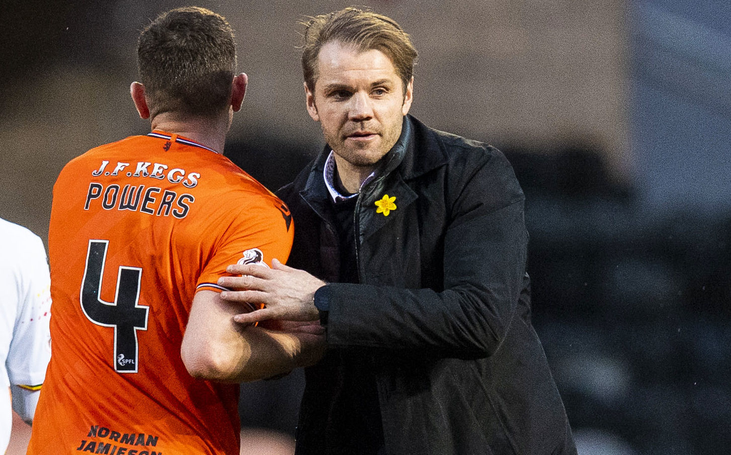 Robbie Neilson, right, greets Dillon Powers at end of Partick game.