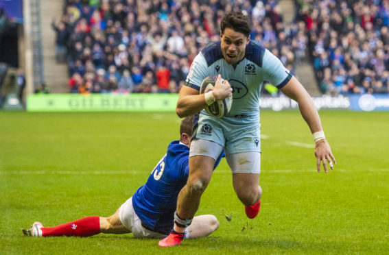 Sean Maitland evades France's Anthony Bouthier to score his and Scotland's second try against France in March.