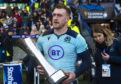 Stuart Hogg with the Auld Alliance Trophy after the win over France.