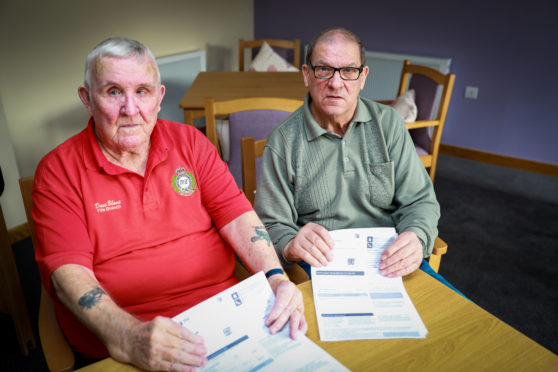 Dave Blane, 79,and Drew Barnes, 73,  with their Den Court utility bills.