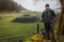 Farmer Andrew Stevenson at the site of the sinkhole after it was filled in by the Coal Authority.