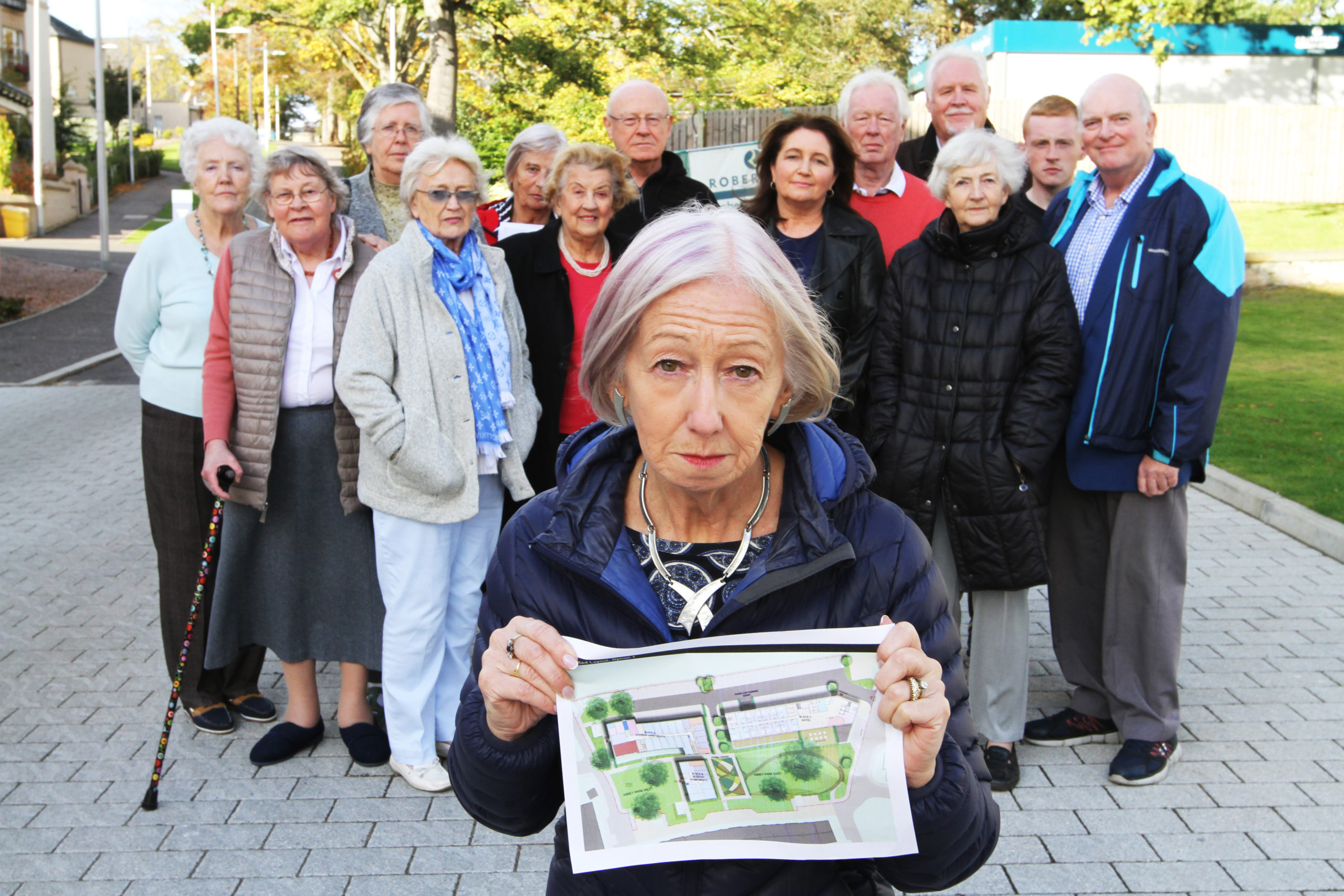 Sandra Stewart, front, and other angry residents.