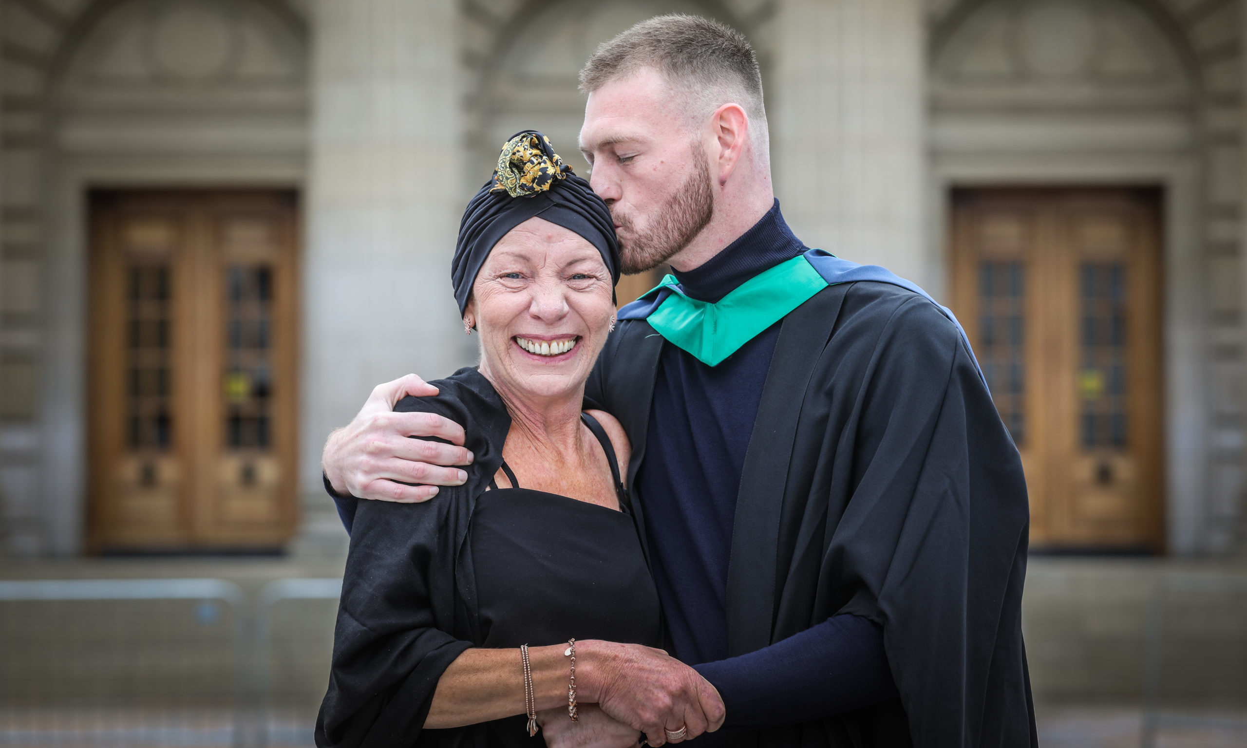 Matilda Latronico with son Sam Latronico, 27, from Perth who graduated in Ethnical Hacking. Mhairi Edwards/DCT Media