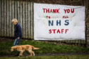 A 'thank you to all NHS staff' banner close to Ninewells Hospital in Dundee.