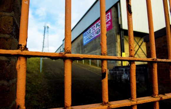 The gates are closed at Tannadice and across Scotland.