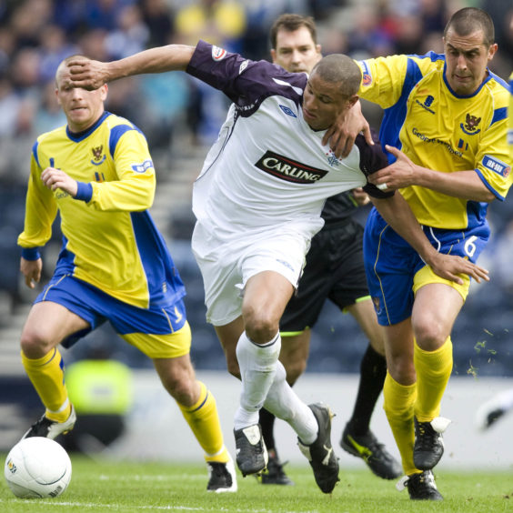 McManus tussles with ex-Rangers striker Daniel Cousin