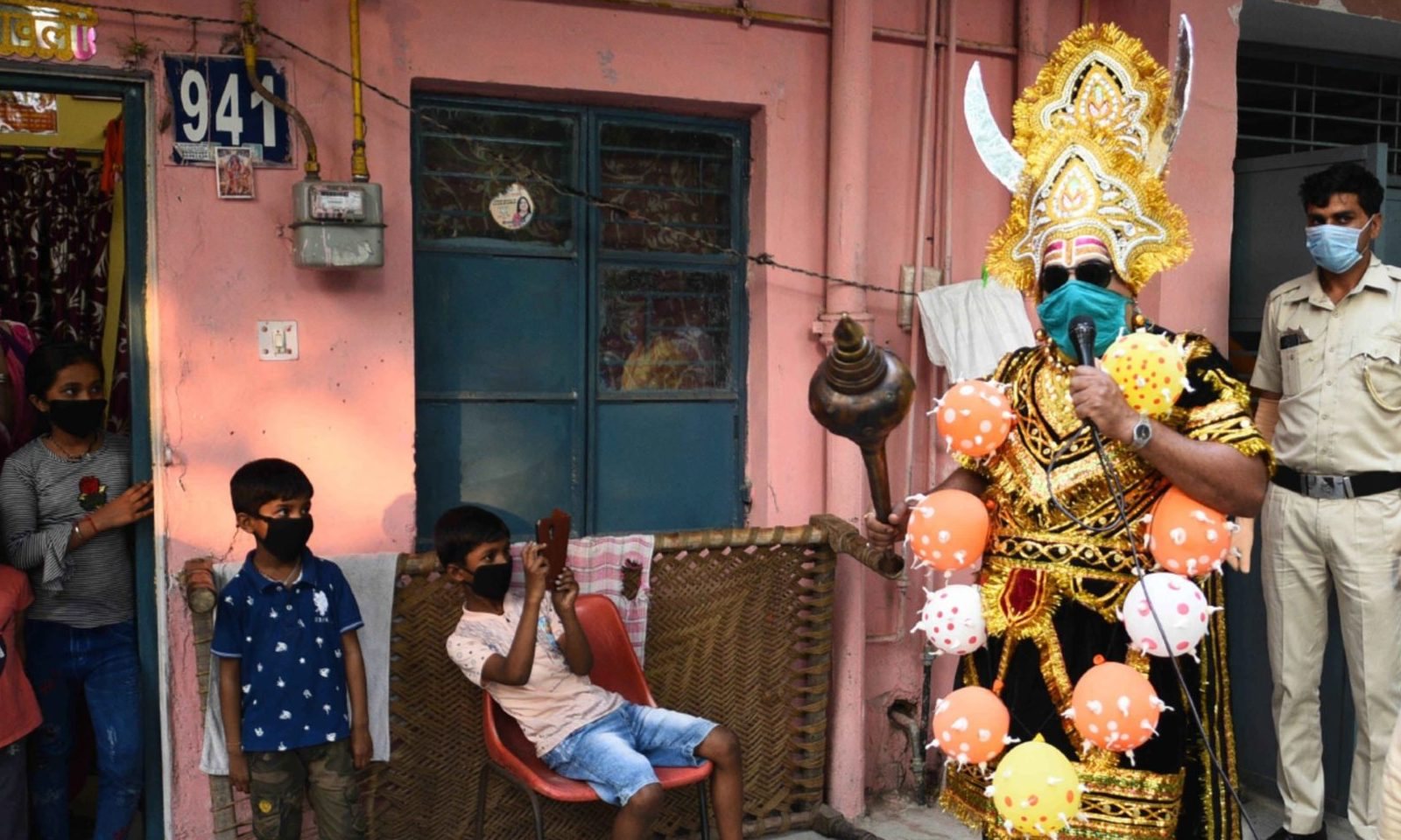A central government employee dressed as Yamraj or Hindu god of death