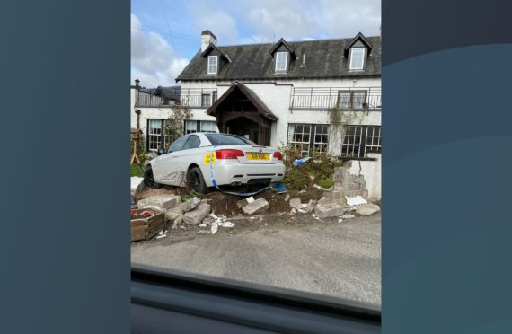 The BMW landed in the garden of Coshieville House B&B.