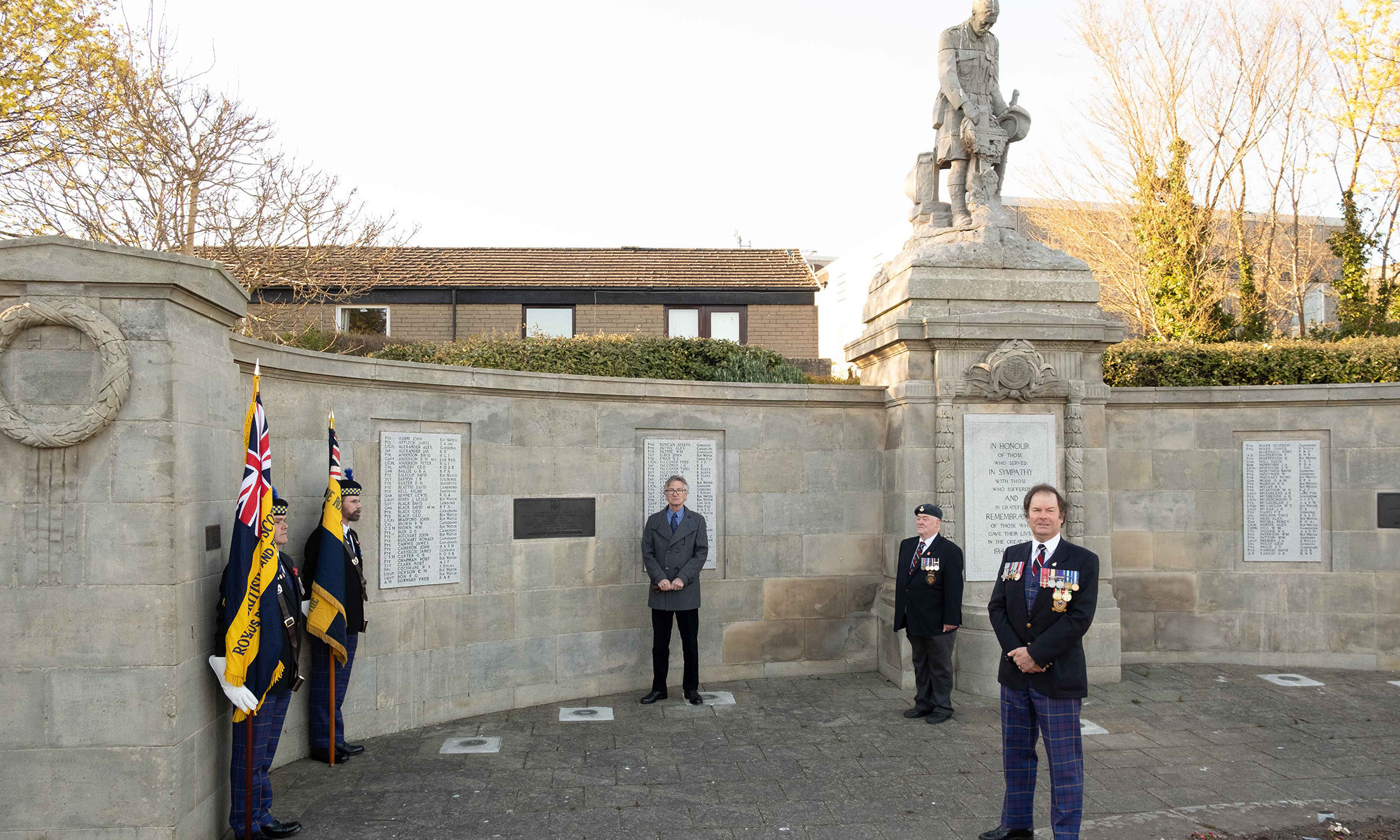 Standard bearers Paul Thomson and Rab Cumming, Darrell Milton, a former Commander in the Royal Australian Navy,  Carnoustie legion vice-chairman Danny Downs and Legion chairman Davie Paton at the Carnoustie memorial.