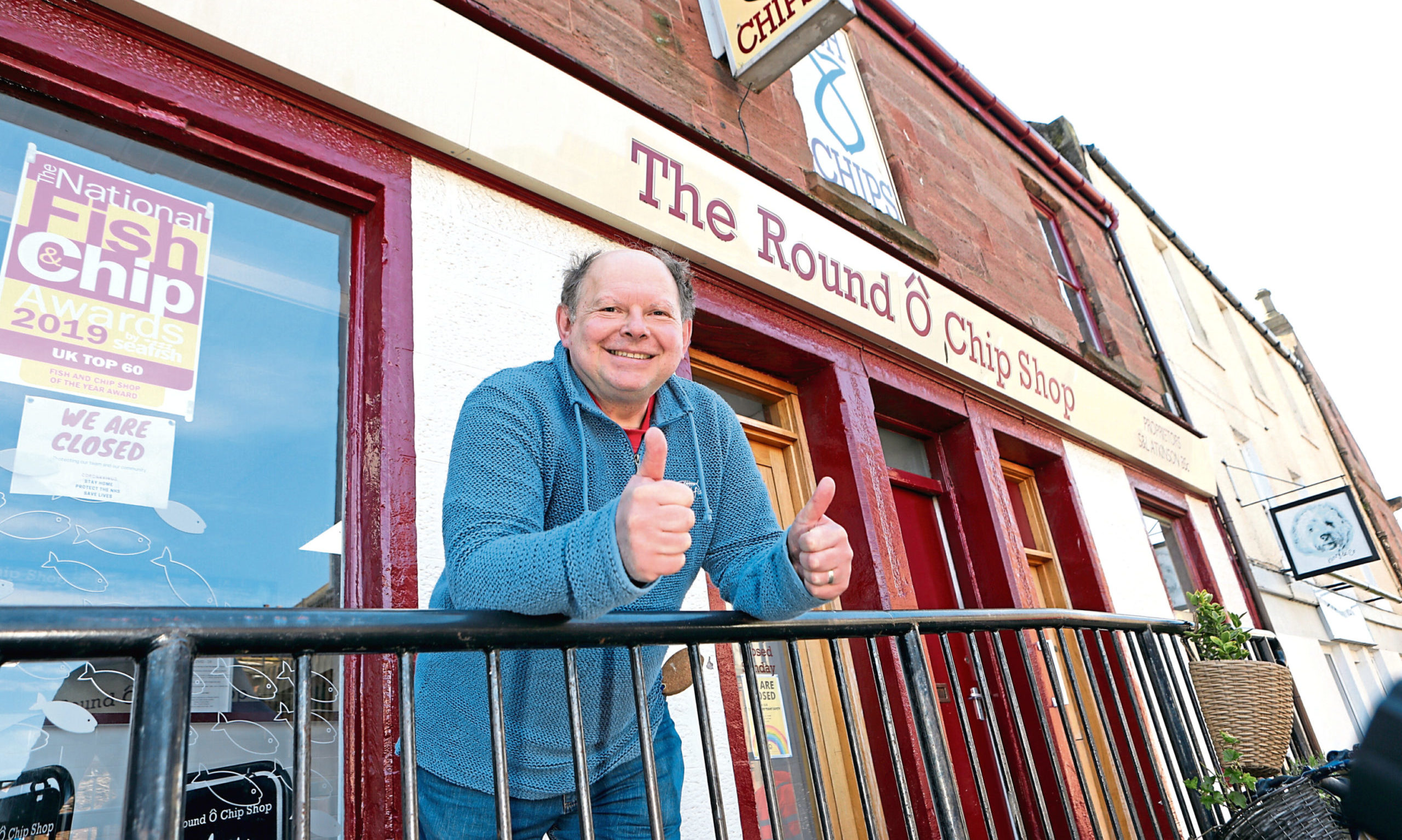 Stuart Atkinson outside one of his chip shops.