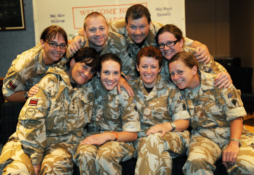 A Squadron arrive back at Bridge of Don Barracks at 3am after a 3 month tour of duty in Afganistan. L-R back: Capt Alison Legge, Cpl Malcolm Milne, Maj Alan Millarvie and Maj Nicola McCullough. Front: Capt Joan Molloy, Cpl Sharon Murray, Cpl Rebecca Dewis and Maj Morag Anderson.