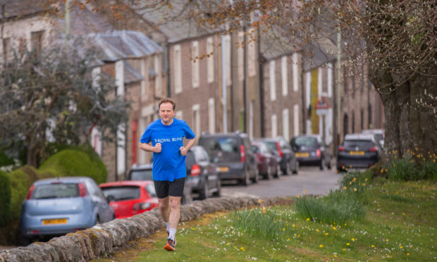 Stephen Coulter running through the streets of Murthly