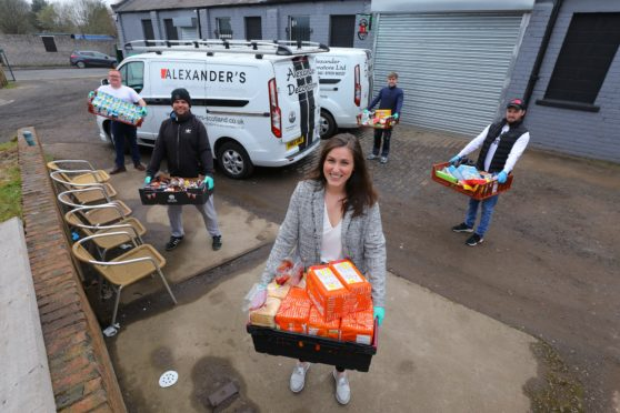John Alexander, Murray Duncan, Kara Swankie, George Alexander and Charlie Lamont at Alexander Community Development with some of the food they are storing and distributing across Dundee.