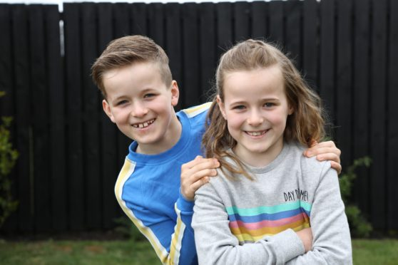 Twins Cole and Orla Cunningham after they raised £850 for the NHS from the Easter Egg Hunt they made up round Dundee.