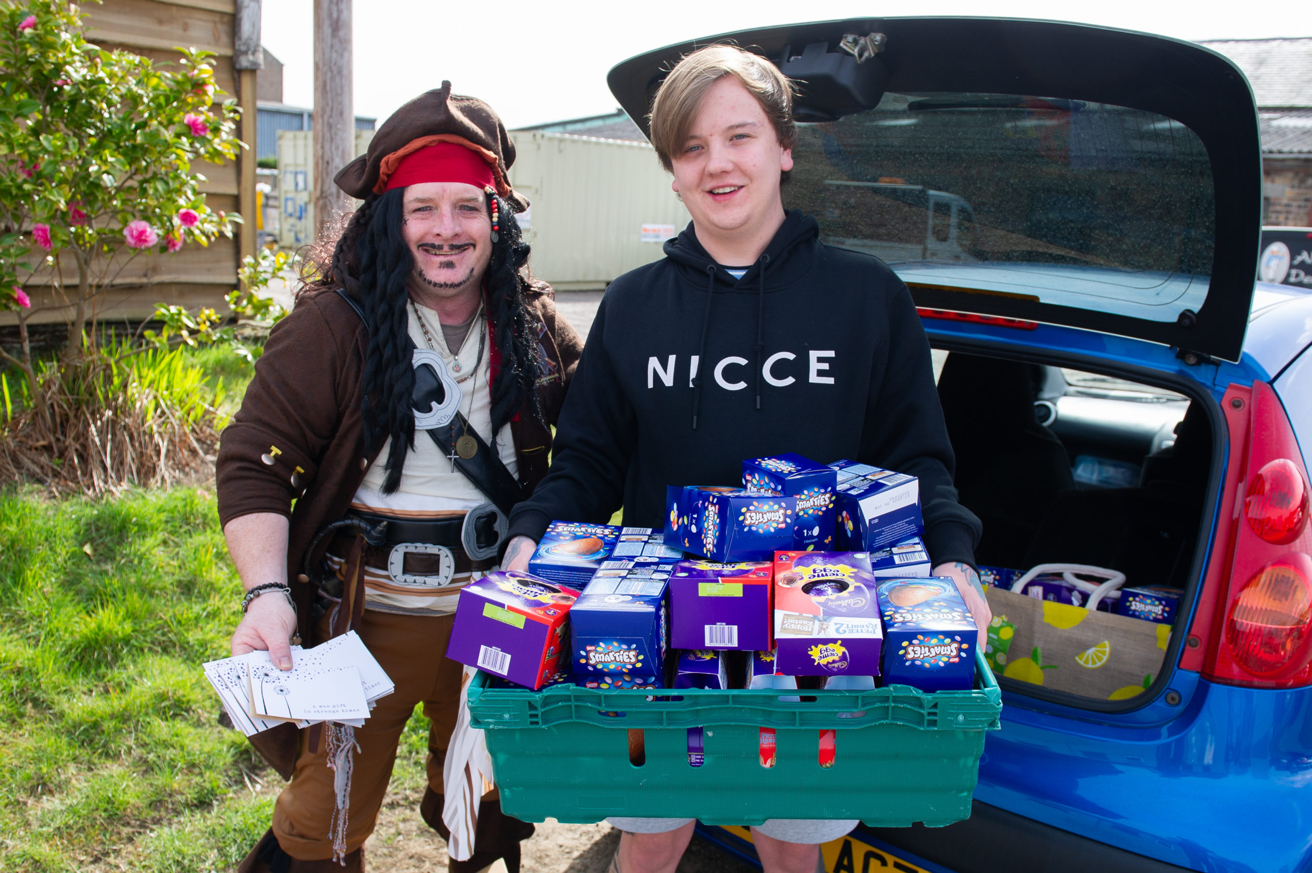 Richard Tart (aka Captain Jack Sparrow) and Lee Mills loading the Easter Eggs ready for distributing in the Linlathen.