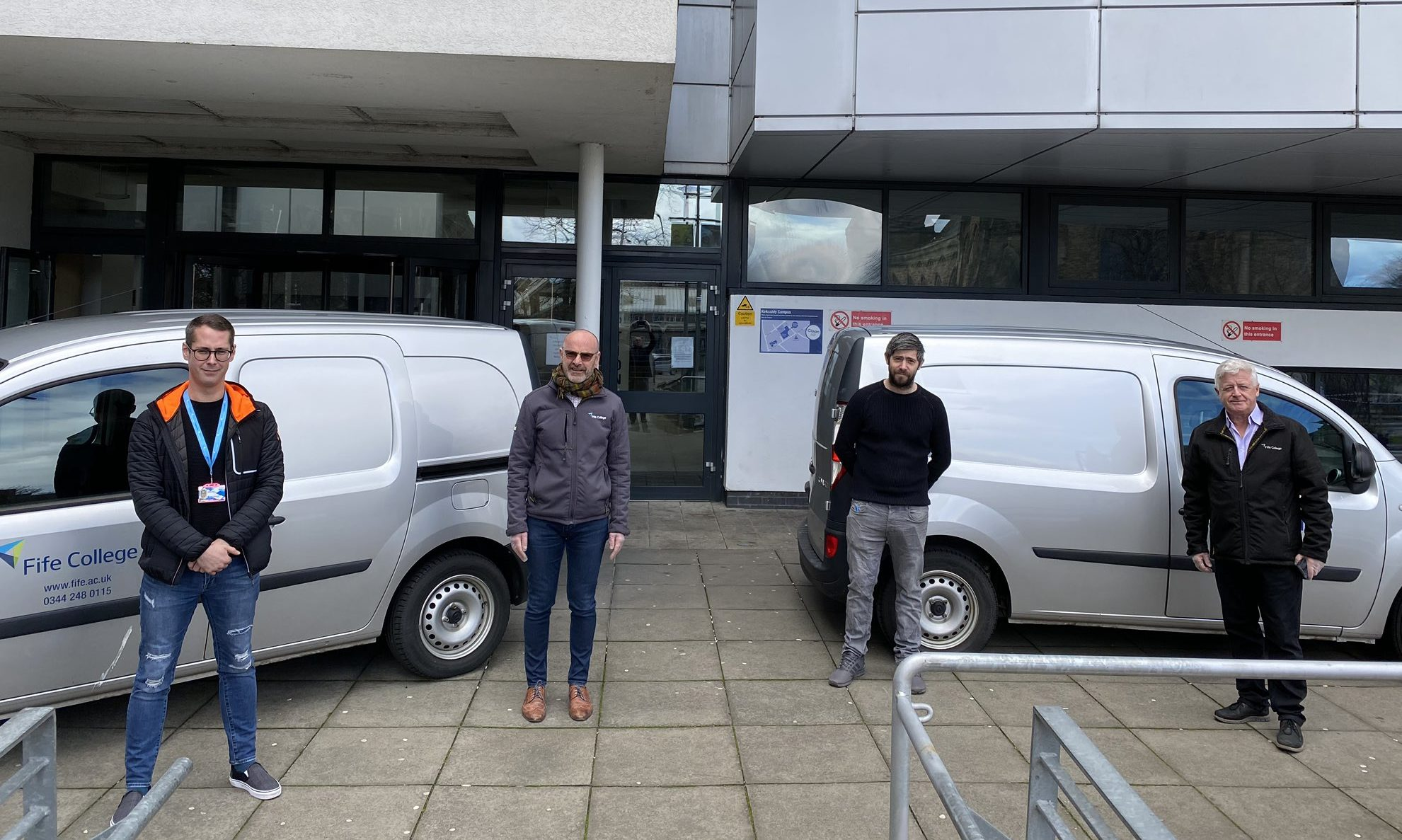 From left, Kris Getchell, chief information officer, Bryan McCabe-Bell, director of business, enterprise and tourism and supported programmes, Stuart McKay, digital services team leader and Hugh Hall, Fife College principal, outside the college's Kirkcaldy campus, preparing to deliver devices the homes of students.