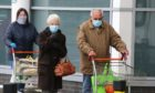 Evening telegraph news CR0020680  Coronavirus Covid-19 G Jennings pics elderly people queue to get in for their shopping at Sainsbury,s Dundee,friday 27th march.