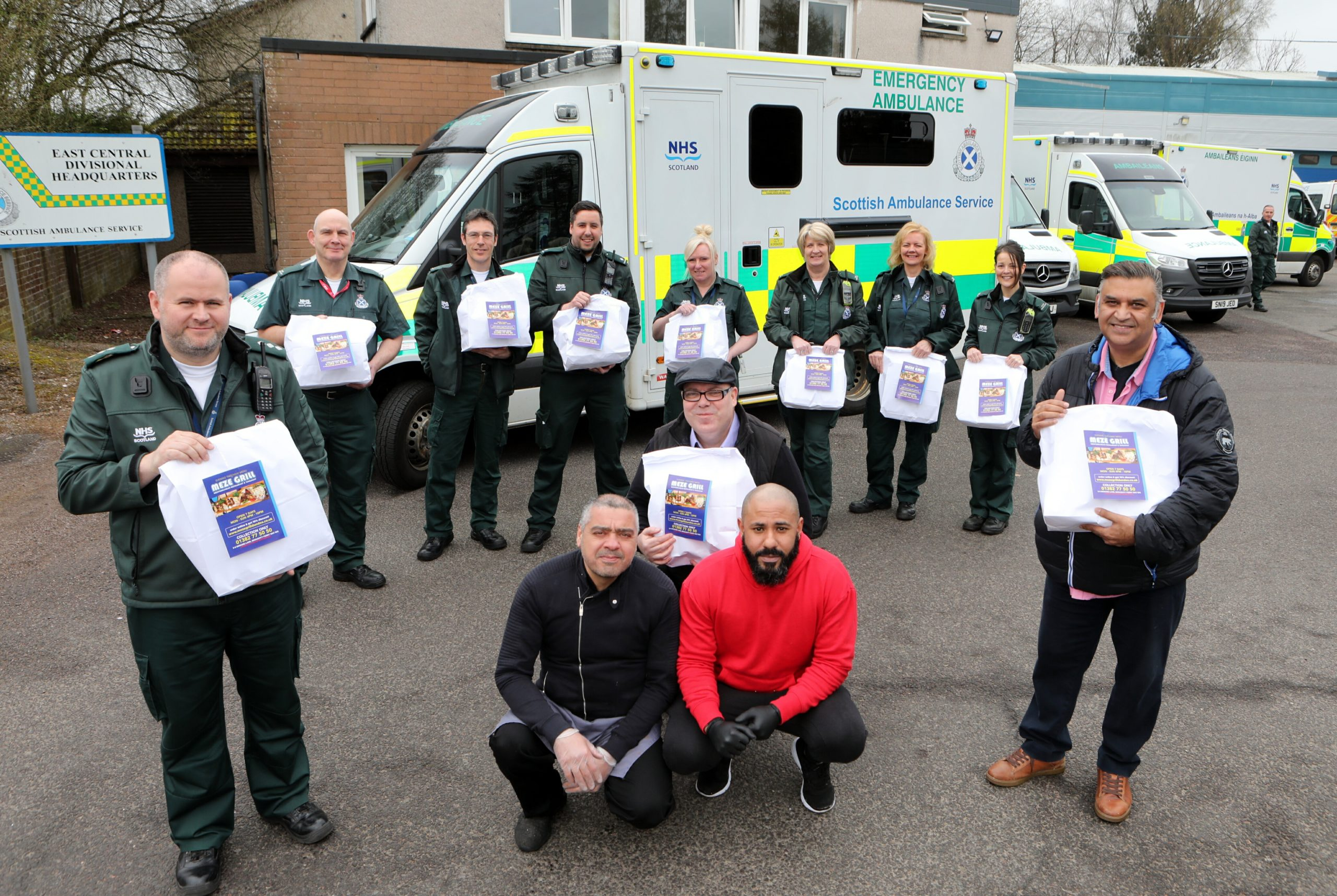 """Stuart Payne (front left), area services manager and the rest of the Scottish Ambulance staff at the Scottish Ambulance Station on West School Road Dundee were treated to meals from Ibrar Ibrahim (front right) ,owner of the """" Meze Grill"""" in Broughty Ferry"""