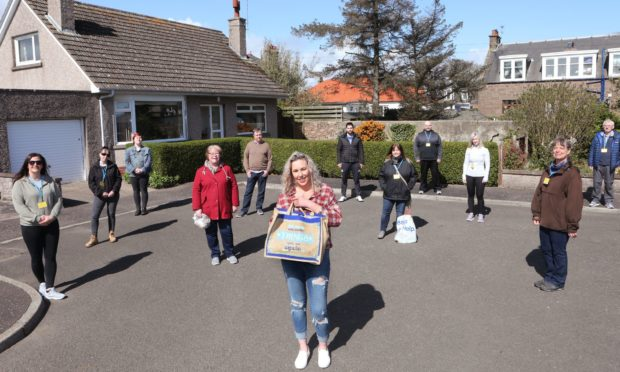 Kelly Christie of Voluntary Action Angus with the rest of the helpers delivering shopping to people in Montrose.