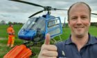 Guy Stephens with his helicopter