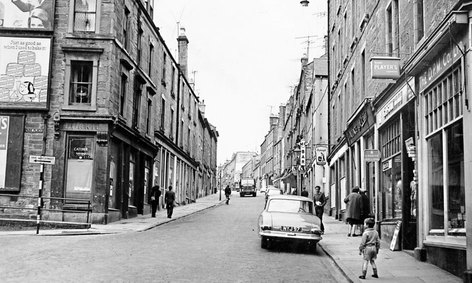 An old photograph looking upwards towards the Hawkhill Shops (Old Westport) from the bottom of Westport, Dundee.