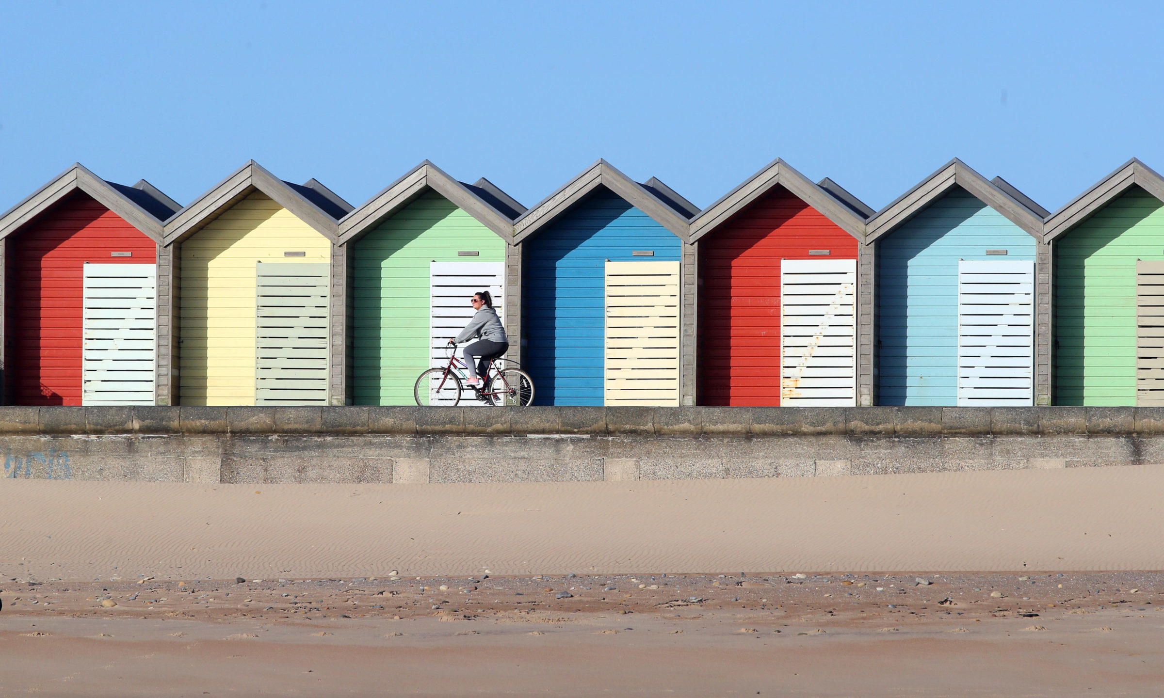 A cyclist takes some exercise at Blyth beach near Whitley Bay in Northern England as the UK continues in lockdown to help curb the spread of the coronavirus. PA Photo. Picture date: Monday April 6, 2020. See PA story HEALTH Coronavirus. Photo credit should read: Owen Humphreys/PA Wire