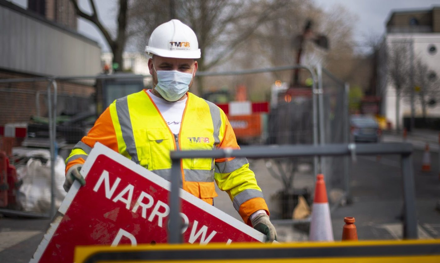 A construction worker wearing a protection face mask in London.