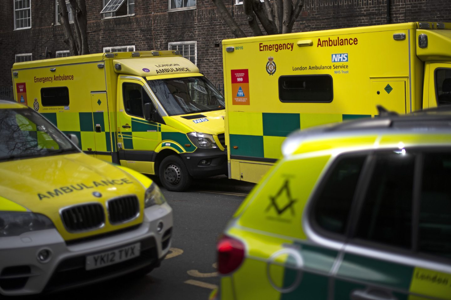 London ambulances line a street in Westminster, London as the UK continues in lockdown to help curb the spread of the coronavirus.