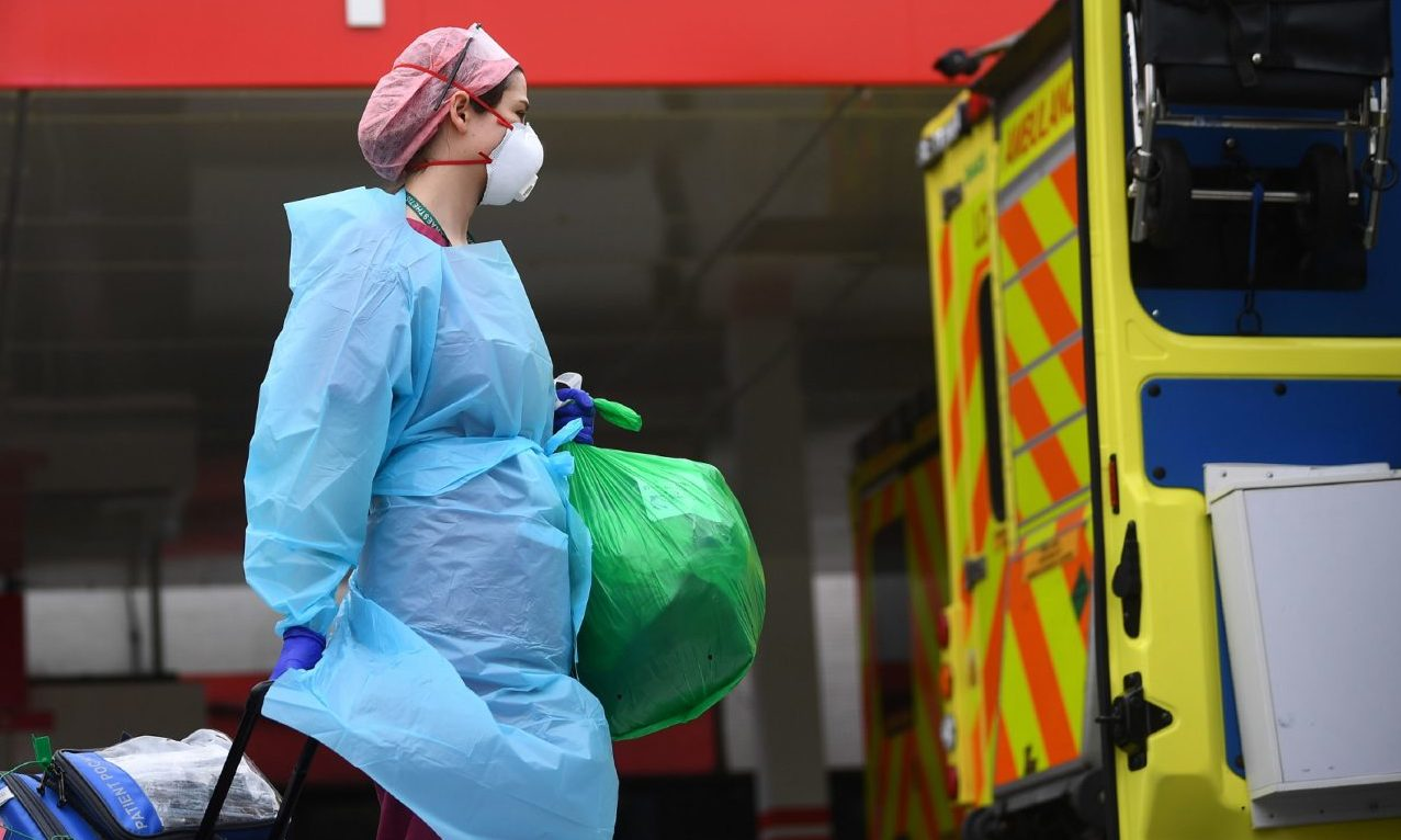 A member of hospital staff wearing personal protective equipment (PPE) outside St Thomas' Hospital in Westminster, London as the UK continues in lockdown to help curb the spread of the coronavirus.