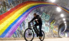 A cyclist passes underneath the rainbow mural in Colinton Tunnel, Edinburgh, as the UK continues in lockdown to help curb the spread of the coronavirus. PA Photo. Picture date: Tuesday April 21, 2020. See PA story HEALTH Coronavirus. Photo credit should read: Jane Barlow/PA Wire