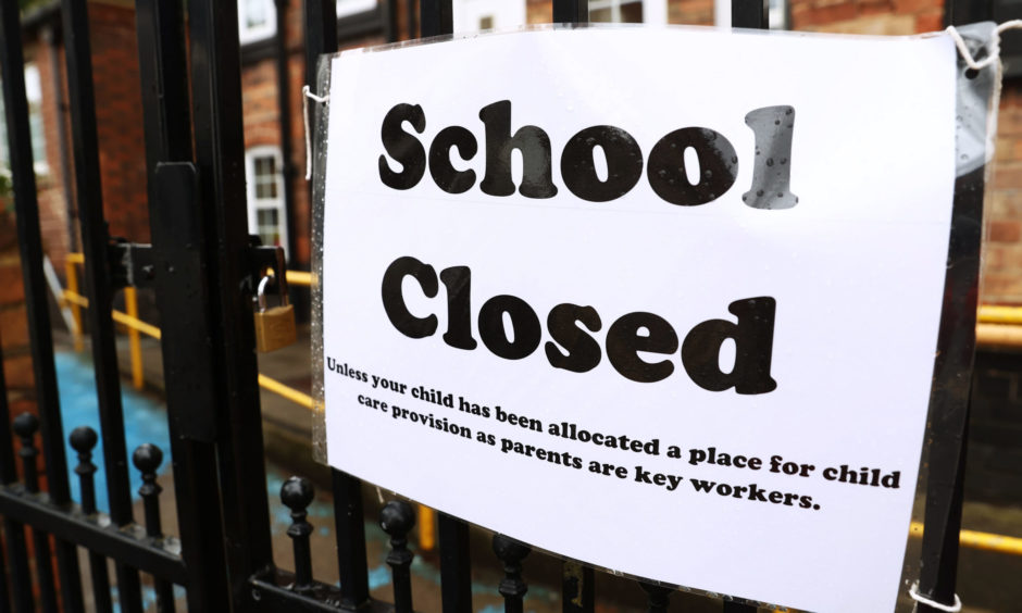 A sign on the gates of a closed school during the lockdown.