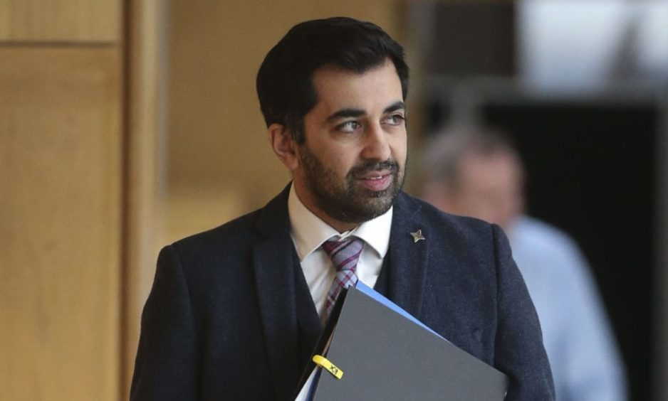 Justice Secretary Humza Yousaf arrives for the Covid-19 emergency legislation debate at the Scottish Parliament.