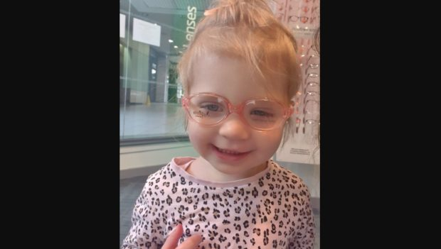 Isabella Payne trying on her new glasses.