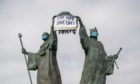 A lockdown message in support of the NHS decorates the Declaration of Independence monument in Arbroath.