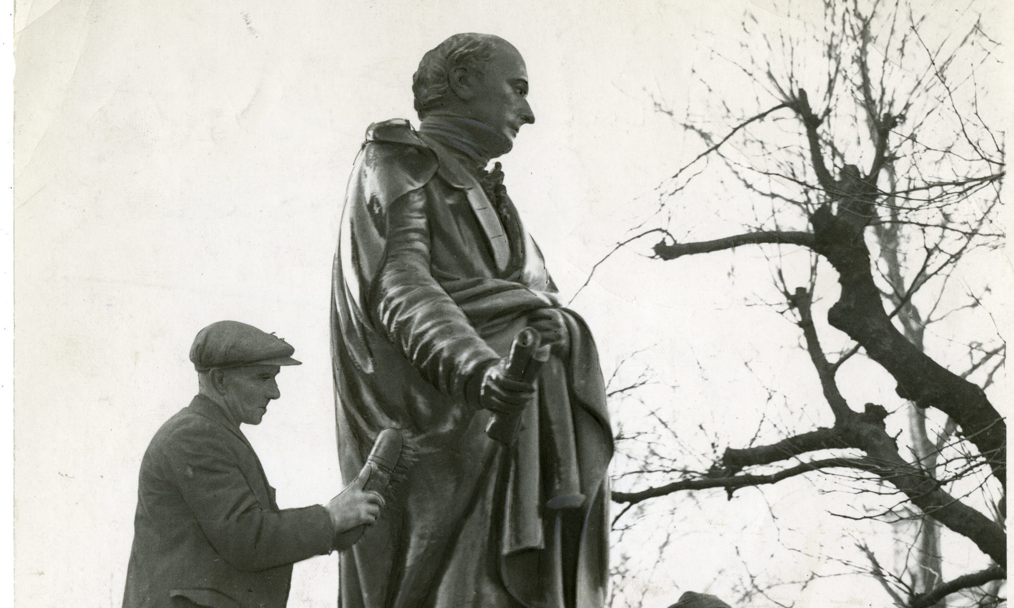 Historic picture of two men cleaning the statue of George Kinloch outside the McManus Galleries in Albert Square, Dundee.