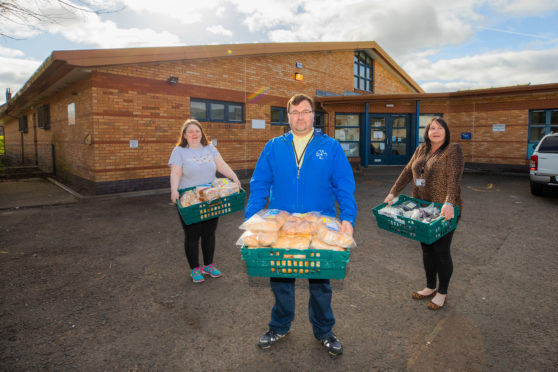 Laura Anderson, Jon Kidd and Sam Skelton of Letham4All with the donations. Picture: Steve MacDougall.