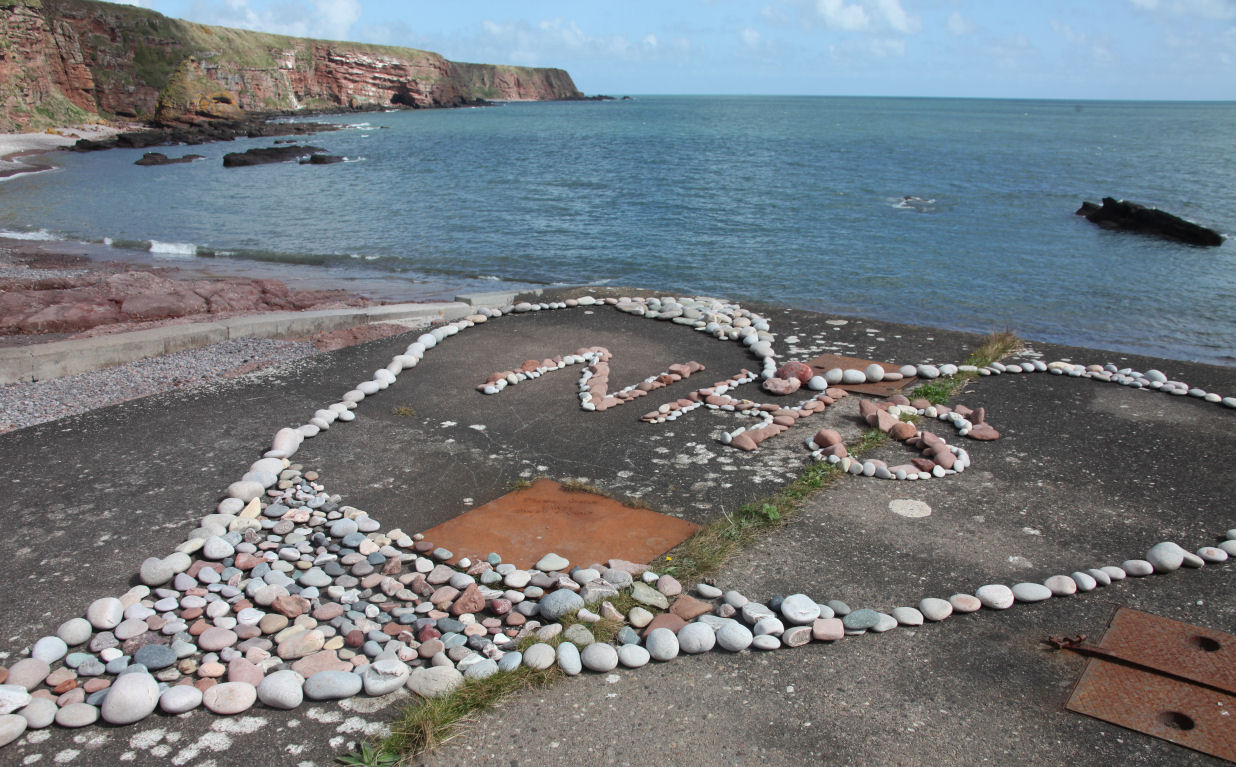 The NHS Heart is being filled with heart-shaped stones at Auchmithie.